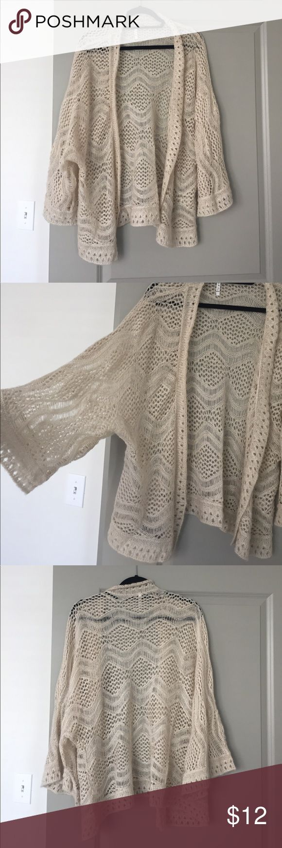 Willow & Clay knit cardigan size L. Cream color Willow & Clay soft knit cardigan. So pretty and vintage-looking. Embraces the 70's vibe. Perfect for work or with a pair of jeans. Size L but would be cute oversized for S or M person. Willow & Clay Sweaters Cardigans