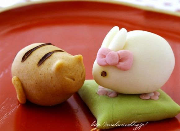 Cat rabbit wagashi. Nerikiri, a traditional Japanese sweet made by mixing shiro-an (sweetened white bean paste) with gyuhi (made of glutinous rice, similar to mochi but softer), then tinted and sculpted into various shapes and styles.