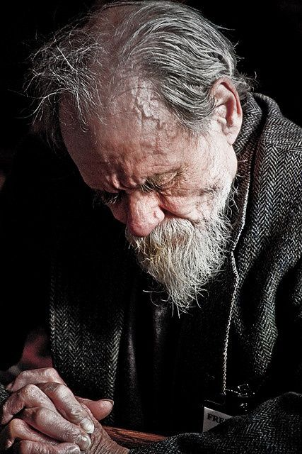 """Brother Bartimaeus : """"He was tall and wiry and bent like a fishhook as his shoulders bowed down under the weight of his years. Whatever hair he had in youth had weathered to silver and long since ceased to cover his head in any meaningful way. Now it just hung on above his ears like moss clung to an old oak. His sun-darkened skin covered him like aged leather and was parted everywhere by creases... but for all his battered coarseness, his way was smooth as water."""" (Peterson, p. 13)"""