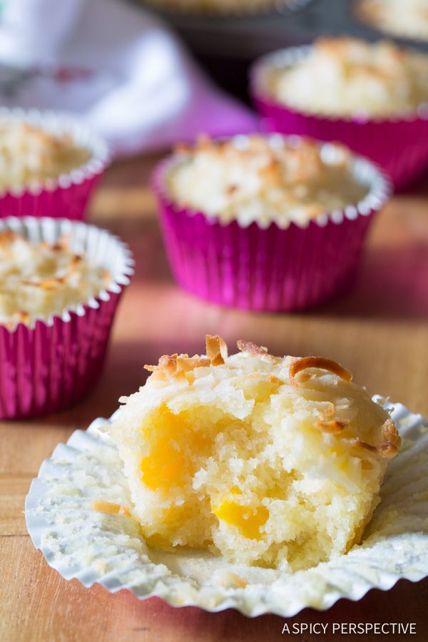 Tropical Breakfast Muffins. Moist and chunky mango coconut pineapple muffins perfect to wake you up with a smile first thing in the morning. A muffin recipe