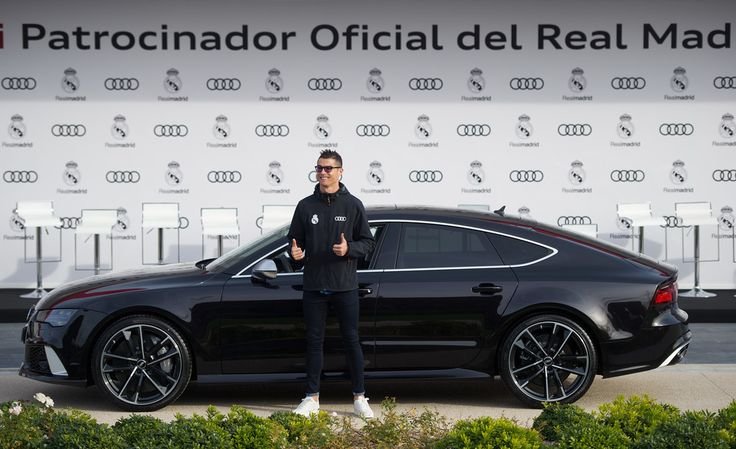 Cristiano Ronaldo Photos - Cristiano Ronaldo of Real Madrid CF poses for a photograph after being presented with a new Audi car as part of an ongoing sponsorship deal with Real Madrid at their Ciudad Deportivo training grounds on November 23, 2017 in Madrid, Spain. - Real Madrid Audi Car Handover