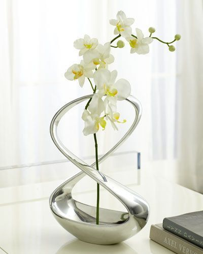 I really love this vase!! Nambe Bud Vase from Neiman Marcus. I love the contemporary shape that artfully wraps around the flowers.