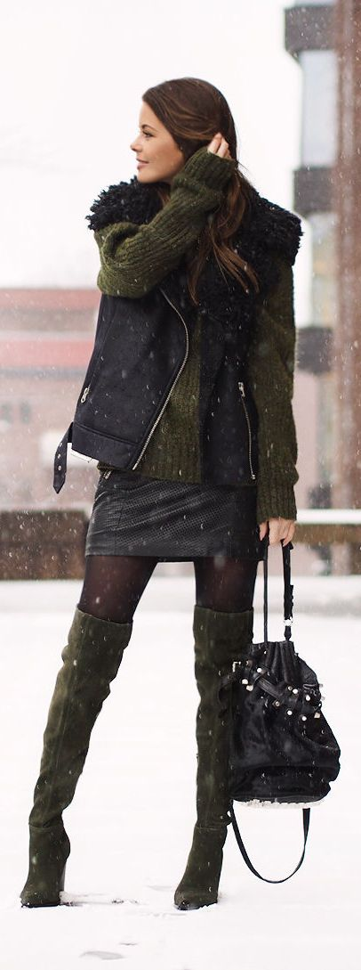 Annette Haga is wearing green thigh high boots from Aldo. (Actually love it all.)