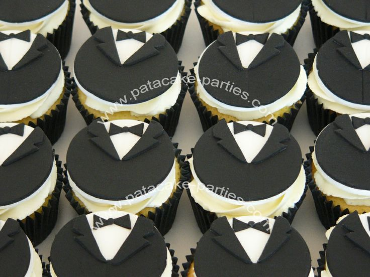 Tuxedo / Dinner Jacket Cupcakes - 30 tuxedo / dinner jacket cupcakes to go with the 007 Communion Cake.  Vanilla sponge with vanilla buttercream swirls and topped with a hand-made topper.