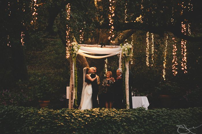 Outdoor evening wedding - love the setting and lights!
