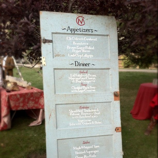 coolest wedding menu - written on an old door!