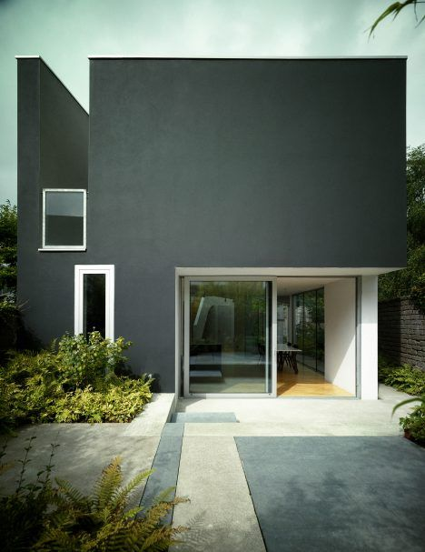 This angular house in Cork, Ireland, was designed by A2 Architects with a crank in its middle to give residents more sun exposure, and to create a route through to a garden courtyard.