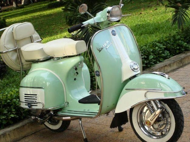 Want! Vintage Vespa in Mint Green.....Google Image Result for http://www.curiouslycolorful.com/wp-content/uploads/2011/07/mintvespa.jpg