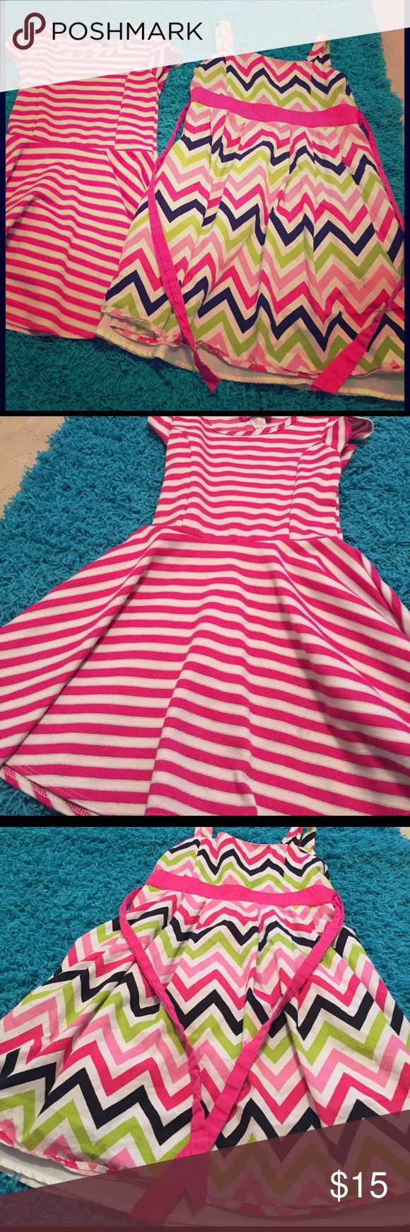 2 girls dresses 6 and 6x pink The pink and white glitter striped cotton dress is a pullover in good condition size 6X the zigzag pink black and green dress is size 6 has lining and netting underneath zipper back and type back bow both in great shape so together at one price Dresses