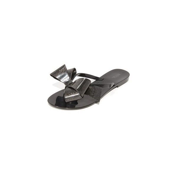 Melissa Harmonic Bow III Thong Sandals (190 BRL) ❤ liked on Polyvore featuring shoes, sandals, flip flops, black gold glitter, toe thongs, melissa flip flops, flat thong sandals, black shoes and black flip flops