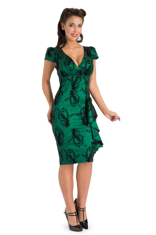 Dark emerald green flocked taffeta sheath with puffed cap sleeves, deep V surplice neckline, front cummerbund waistband with princess seams and faux-wrap effect with 3 black satin-covered shank buttons, knee-length 3-panel fitted skirt with asymmetrical ruffle at right princess seam, rear princess darts, and rear invisible zipper. 65% polyester/30% nylon/5% spandex, by Voodoo Vixen, £49.95