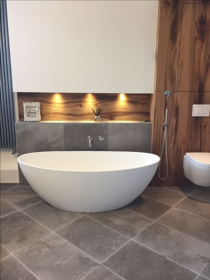 Our Dove Grey Limestone was sent all the way to Germany to be used in this stunning bathroom. We love the beautiful grey tones.