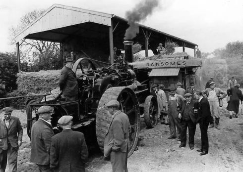 """Mr. R Whipps, of Ipswich, sent in this picture. He said: Mr. R Whipps, of Ipswich, sent in this picture. He said: """"This is a photo of Mr Harold Whipps (my uncle) standing on his Ruston & Proctor traction engine, which was threshing some wheat or barley on Mr Feveayear's farm at Wingfield i in 1972."""