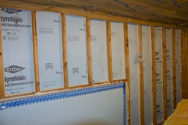 Walk-out Basement Wall Insulated with DOW Foam Board how to insulate above the masonry wall