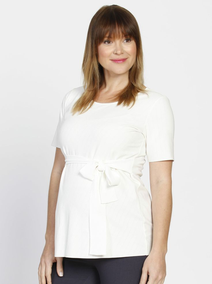 Our Short Sleeve Work Top with Tie Waist in Off White, $49.95, will display your gorgeous blossoming bump in all its glory.