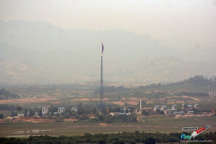 Kijong-dong, North Korea, with the world's third-largest flagpole. The houses and apartment blocks that can be seen are apparently just empty concrete shells painted to look like real dwellings.  An Adventure in the Korean De-Militarised Zone (DMZ) http://www.confiscatedtoothpaste.com/korean-de-militarised-zone-dmz/