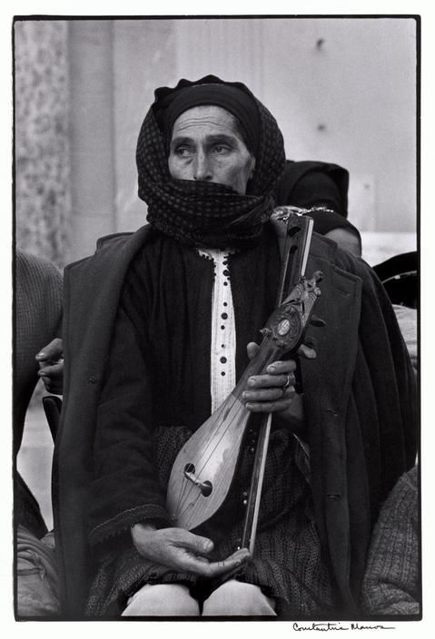 "Constantine Manos. Greece. Karpathos. Olympos. 1964. Woman and Lyra. ""A Greek Portfolio"" p.115. © Costa Manos/Magnum Photos"