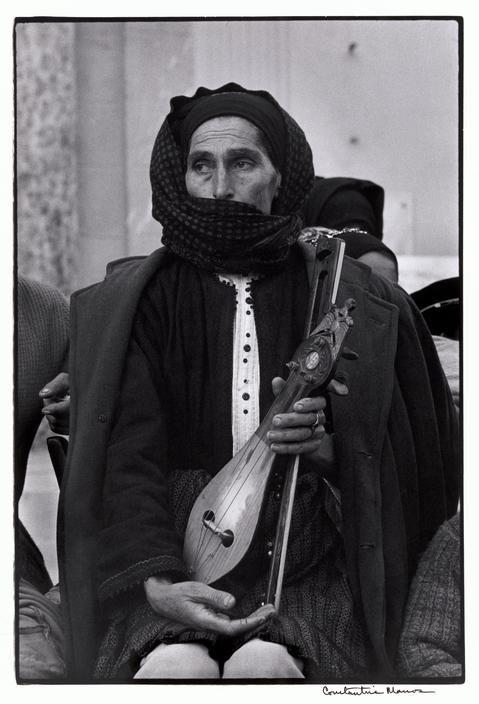 "Constantine Manos. Greece. Karpathos. Olympos. 1964. Woman and Lyra. ""A Greek Portfolio"" p.115. © Costa Manos/Magnum Photos"