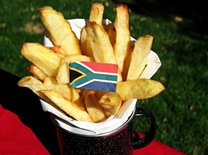 "South African ""Slap Chips (French Fries) {My South African friend would love that I pinned this! ;) Lol} - """"Slap"" (as in ""cup"") in Afrikaans means ""soft"" and our slap chips are soft with a crunchy exterior. The potato slices are first given a vinegar bath which gives the chips/fries that unique flavour and are then fried twice to get the ""crunchy on the outside, soft on the inside"" effect."""