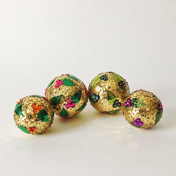 Gold and Floral Sequin Ornament - The Aloha Ball - Handcrafted Holiday and Home Decor  The perfect sparkly ornament for a Christmas tree or a bright and colorful bowl filler, this gold and floral sequin ornament makes for some incredibly unique decor! Inspired by Hawaiian florals and vintage handcrafted sequin ornaments, the Aloha ball is a sunny addition to our collection of handcrafted sequin ornaments.