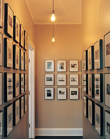The flat walls of a hallway are the perfect place for a home gallery.