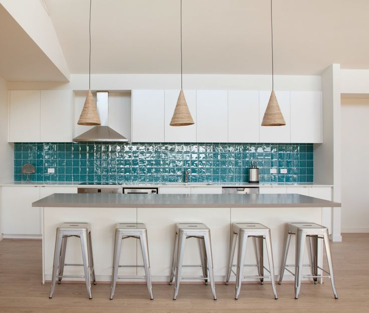 We helped bring this kitchen to life with a splash of teal and silver!