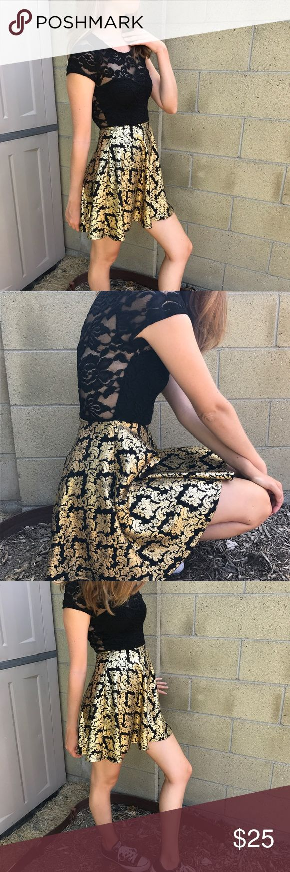 Night out dress Super fun n' flirty dress perfect for a girls night out! I wore it as a formal dress but looks just as cute dressed down with converse! Has a see through lace back and a slightly flared skirt with a gold and black pattern. Could fit an xs or s Windsor Dresses Mini