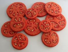 Needle-felted tomatoes by artist Martina Celerin.  http://martinacelerin.blogspot.com/2011/04/summertime-tomatoes-sliced-and-ready.html