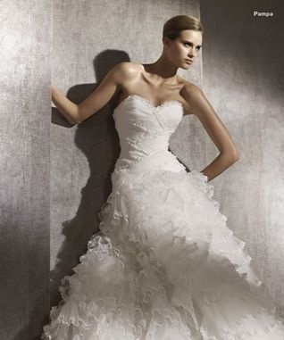 """This sensational dress is from the Pronovias 2012 Dreams Collection. This style """" Pampa"""" features a sweetheart neckline. The dress has fabulous layers of lace-edged tulle; vertical, horizontal or diagonal. These frills give body and movement to the skirt. These unashamedly tenderly-created gowns that sum up the excitement of so many months of planning and preparation."""
