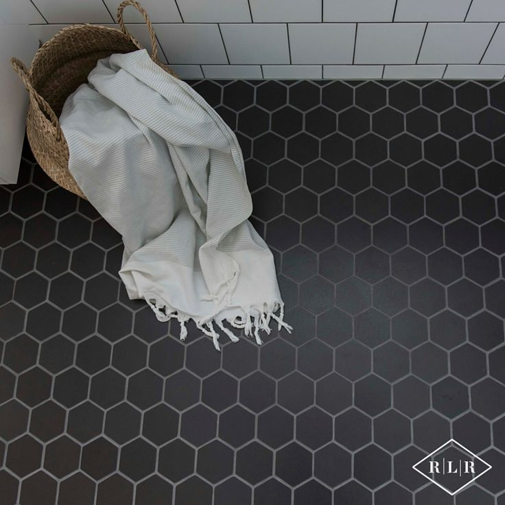 Red Lily Renovations Bathroom - Perth. Black mosaic hexagonal tiles. Turkish towels from Kmart. Basket from Ikea.