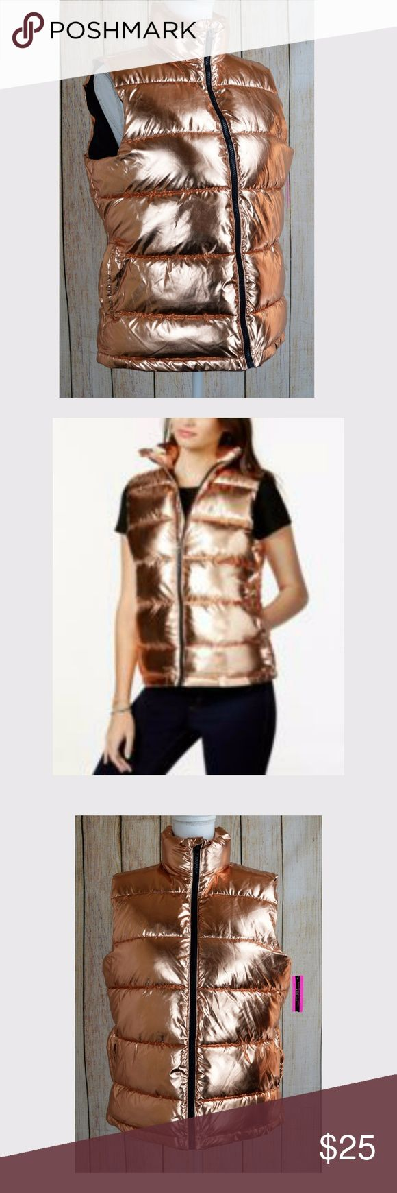 "Active Juniors' Puffer Vest Jacket Coat Rose Gold Please Verify Measurements Up For Sale New with tags Material Girl Active Juniors' Puffer Vest  Jacket Coat Top Rose Gold X-Small XS $59.50  Measurements are measured across: Armpit to armpit 19.5"" Shoulder 14"" Hem 20"" Length 23""  BRAND: Material Girl Active  SIZE:  Small S CONDITION: New with tags  COLOR: Rose Gold STYLE:  Puffer Vest  MATERIAL: 100% Polyester  MWC02-01 Material Girl Active Jackets & Coats Vests"