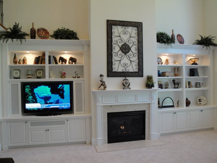 Fireplace built ins autumnwood designs 39 home theater for Fireplace cabinet ideas