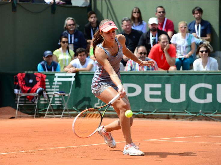 Unseeded Andreea Mitu triumphed over No.12 seed to reach the third round, where she overcame former French Open champ Francesca Schiavone for a spot in the Round of 16.