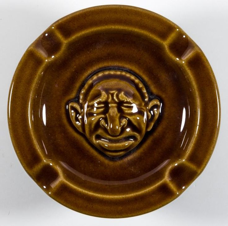 """DER STURMER"" ANTI-SEMITIC ASHTRAY  An insulting anti-Semitic ashtray given as a gift by Julius Streicher''s newspaper ""Der Sturmer"". The brown porcelain ashtray, 5 3/4"" diameter, bears at center in high relief a caricature of a grimacing Jew, typical of the artwork found in Streicher''s many publications"