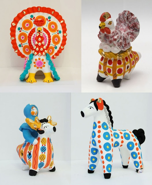 Dymkovo toys, also known as Vyatka or Kirov toys, are moulded painted clay figures traditionally  made by women in the form of birds,horses, horseriders, ladies and other people and animals.