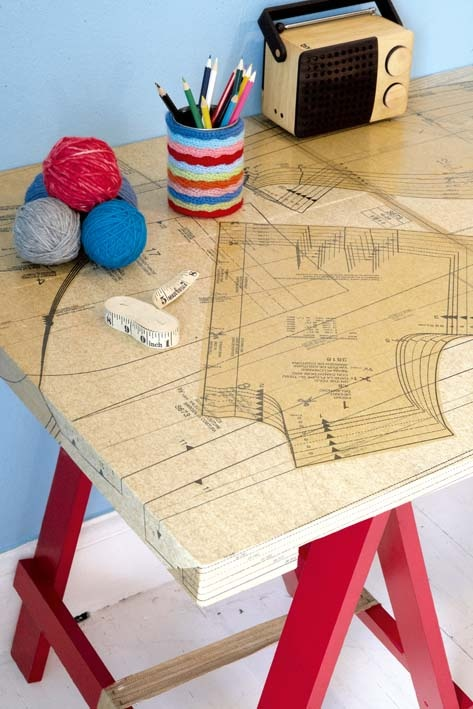 decoupaged table ... AWESOME for my sewing room! - would love to use favorite or special pattern pieces