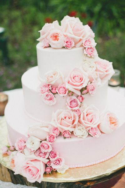 Pink wedding cake with pink roses: http://www.stylemepretty.com/2014/08/01/gold-and-blush-hued-outdoor-wedding-in-malibu/   Photography: Onelove - http://www.onelove-photo.com/