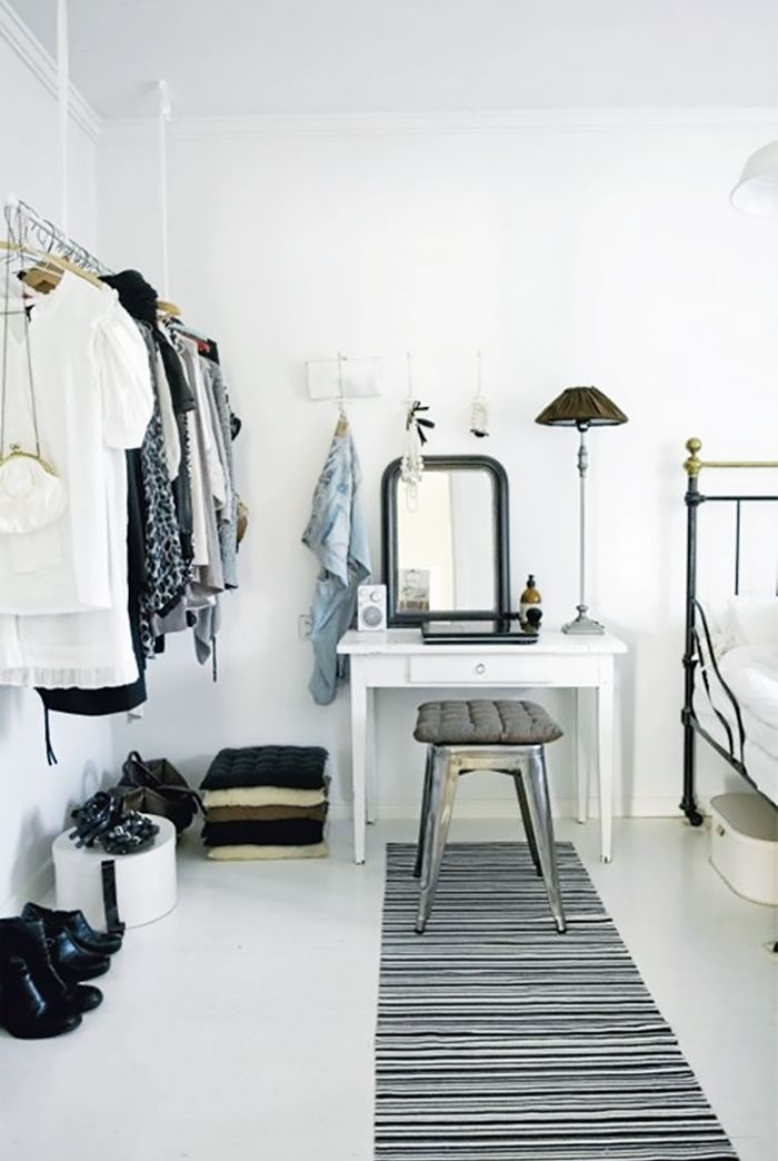 A hanging clothing rack meshes well with neutral room décor