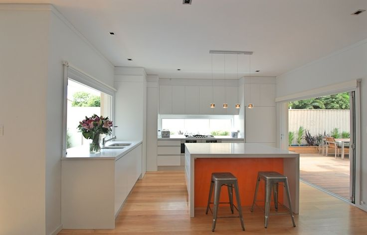 White with a pop of orange at Penshurst Ave kitchen by Bijl Architecture