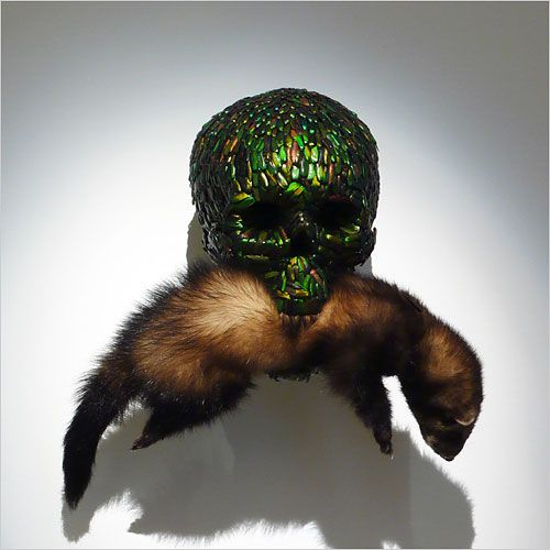 Skull sculpture made of jewel-scarab wing cases by Jan Fabre