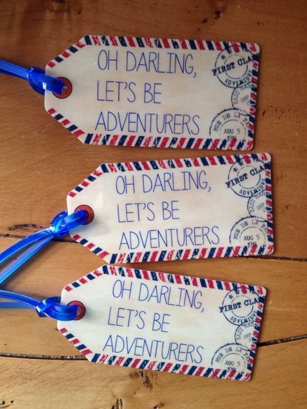 Luggage tags as travel wedding favors and place cards (names written on back).