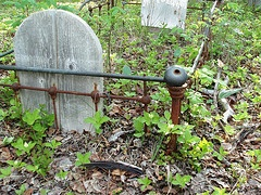 In A lot of Dawson City's cemetary a few of the children's graves are surrounded by their cradles.