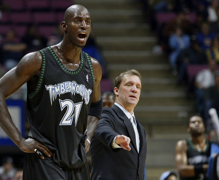 Minnesota Timberwolves head coach Flip Saunders and Kevin Garnett react on the sidelines during a game against the New Jersey Nets on Oct. 31, 2003 at Continental Airlines Arena in East Rutherford,...