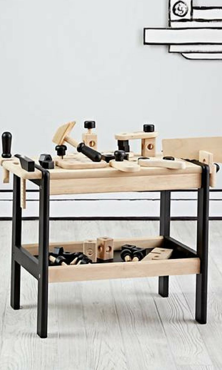 An eco-friendly kids wooden tool bench. Great for open ended pretend play activities!