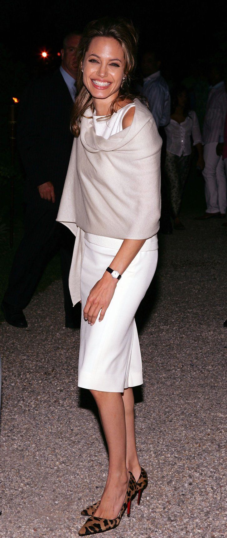 Pin for Later: How Vampy Did Angelina Jolie Go For Her Wedding? Angelina Jolie's Red Carpet Transformation She looked pristine in a little white sheath and pop of print, via leopard shoes, in 2005.