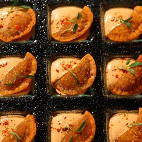 Mini Jamaican beef patties with scotch bonnet cream and micro cilantro. (From Chef Roble)  Oh my gosh.. YES!! I only wish they were a little bigger and baked not fried  Wedding party favors