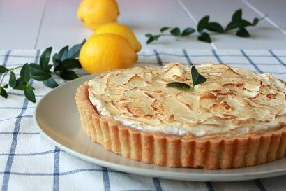 Lemon curd filling in a shortbread crust topped with toasted meringue.