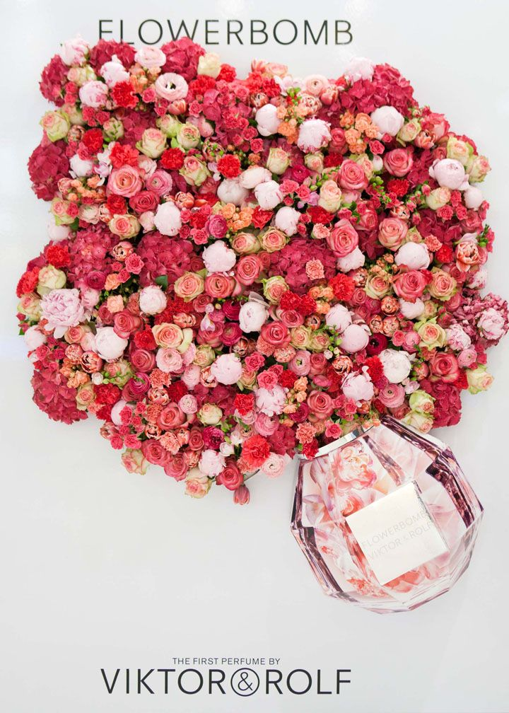 Flowerbomb has an explosion of floral notes and sensations, thus the explosion of a bouquet of flowers bursting out of a larger than life size bottle of perfume. Real flowers in red, pink and white are strategically placed to create balance, texture and immediately convey the types of scents the perfume contains. This is a great example of using props that connect perfectly with the product. It's visually enticing while adding curiosity to passers by to try a sample spritz.
