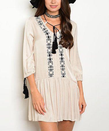 This Beige & Black Tassel Peasant Dress is perfect! #zulilyfinds