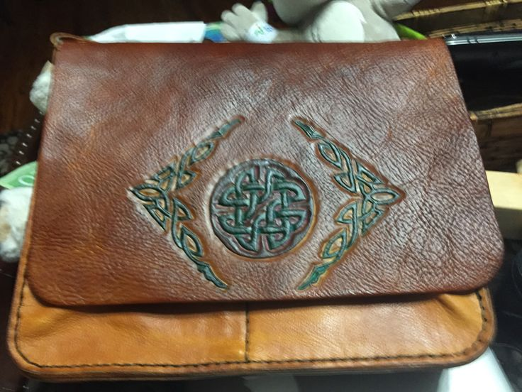 Horizontal leather messenger bag.
